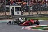 Carlos Sainz Jr (ESP) Ferrari SF-21 and Yuki Tsunoda (JPN) AlphaTauri AT02 battle for position.