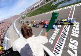 Jimmie Johnson leads the field to the green in Las Vegas