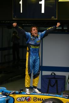 Renault`s Fernando Alonso celebrates the third place that allowed him to become 2005 F1 world champi