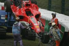 Ferrari`s Michael Schumacher crashes out of Saturday morning`s first practice session at Suzuka - he