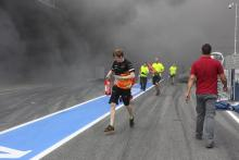 13.05.2012- A fire in the Williams pit garage after the celebrations is tended to by members of all