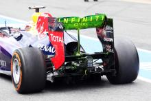 Sebastian Vettel (GER) Red Bull Racing RB9 running flow-vis paint on the rear wing and rear diffuser