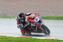 Dixon masters wet opener, Haslam recovers to third