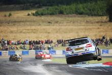 Sutton storms to race one victory