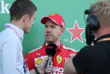 Vettel: F1 should return to traditional chequered flag