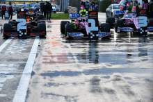 The top three in parc ferme: Max Verstappen (NLD) Red Bull Racing RB16, second; Lance Stroll (CDN) Racing Point F1 Team RP20, pole position; Sergio Perez (MEX) Racing Point F1 Team RP19, third.