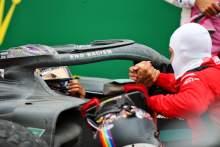 Race winner and World Champion Lewis Hamilton (GBR) Mercedes AMG F1 celebrates in parc ferme with third placed Sebastian Vettel (GER) Ferrari.