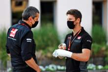 (L to R): Guenther Steiner (ITA) Haas F1 Team Prinicipal with Romain Grosjean (FRA) Haas F1 Team.
