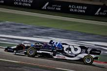George Russell (GBR) Williams Racing FW43B and Yuki Tsunoda (JPN) AlphaTauri AT02 battle for position.