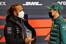 (L to R): Lewis Hamilton (GBR) Mercedes AMG F1 with Sebastian Vettel (GER) Aston Martin F1 Team in the FIA Press Conference.