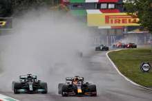 Max Verstappen (NLD) Red Bull Racing RB16B and Lewis Hamilton (GBR) Mercedes AMG F1 W12 battle for position.