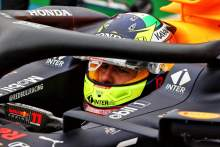 Sergio Perez (MEX) Red Bull Racing RB16B in the pits while the race is stopped.