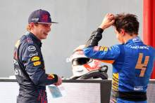 (L to R): Race winner Max Verstappen (NLD) Red Bull Racing and third placed Lando Norris (GBR) McLaren in parc ferme.