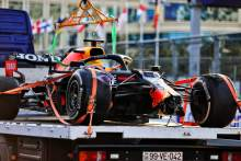 The Red Bull Racing RB16B of race retiree Max Verstappen (NLD) Red Bull Racing is recovered back to the pits on the back of a truck.