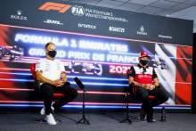 (L to R): Valtteri Bottas (FIN) Mercedes AMG F1 with Kimi Raikkonen (FIN) Alfa Romeo Racing in the FIA Press Conference.