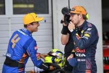 (L to R): Second placed Lando Norris (GBR) with Max Verstappen (NLD)