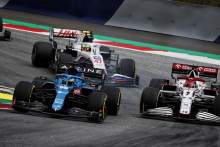 Fernando Alonso (ESP) Alpine F1 Team A521 and Kimi Raikkonen (FIN) Alfa Romeo Racing C41 battle for position.