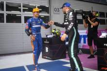 (L to R): Lando Norris (GBR) McLaren celebrates his third position in parc ferme with second placed Valtteri Bottas (FIN) Mercedes AMG F1.