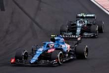 Esteban Ocon (FRA) Alpine F1 Team A521 leads Sebastian Vettel (GER) Aston Martin F1 Team AMR21.
