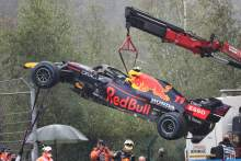 The Red Bull Racing RB16B of Sergio Perez (MEX) is craned away from the circuit after he crashed heading to the grid.