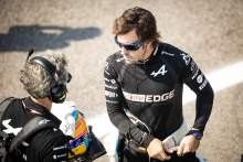 Fernando Alonso (ESP) Alpine F1 Team with Edoardo Bendinelli (ITA) Alpine F1 Team Personal Trainer on the grid.