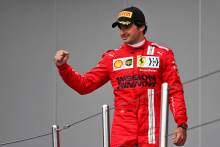 Carlos Sainz Jr (ESP) Ferrari celebrates his third position on the podium.