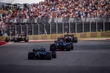 George Russell (GBR) Williams Racing FW43B leads Sebastian Vettel (GER) Aston Martin F1 Team AMR21.