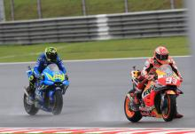 Marquez takes wet Sepang pole despite fall