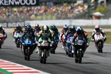 Moto3: McPhee hangs on after last lap highside