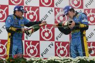 Renault team-mates Giancarlo Fisichella and Fernando Alonso share champagne on the Japanese GP podiu