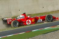 Rubens Barrichello recovers from the gravel trap after coming together with David Coulthard at Suzuk