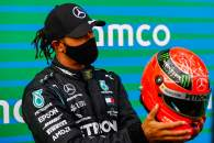 Race winner Lewis Hamilton (GBR) Mercedes AMG F1 is presented with the helmet of Michael Schumacher (GER) in parc ferme after equalling the record for the number of F1 victories.