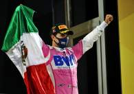 Race winner Sergio Perez (MEX) Racing Point F1 Team celebrates on the podium.