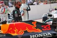 Lewis Hamilton (GBR) Mercedes AMG F1 looks at the Red Bull Racing RB16B.