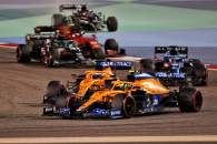 Lando Norris (GBR) McLaren MCL35M and Daniel Ricciardo (AUS) McLaren MCL35M battle for position.