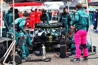 Sebastian Vettel (GER) Aston Martin F1 Team AMR21 on the grid with work being done on the rear brakes.