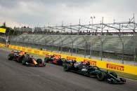 Lewis Hamilton (GBR) Mercedes AMG F1 W12 leads Sergio Perez (MEX) Red Bull Racing RB16B and Max Verstappen (NLD) Red Bull Racing RB16B at the start of the race.