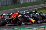 (L to R): Sergio Perez (MEX) Red Bull Racing RB16B and Sebastian Vettel (GER) Aston Martin F1 Team AMR21 battle for position.