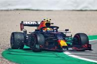 Sergio Perez (MEX) Red Bull Racing RB16B spins during qualifying.