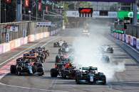 Lewis Hamilton (GBR) Mercedes AMG F1 W12 locks up under braking at the restart of the race while attempting to pass Sergio Perez (MEX) Red Bull Racing RB16B.