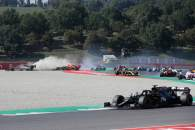 Max Verstappen (NLD) Red Bull Racing RB16 crashes out of the race with Romain Grosjean (FRA) Haas F1 Team VF-20 and Kimi Raikkonen (FIN) Alfa Romeo Racing C39.